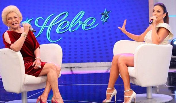 Sofá, poltrona, cadeira... o importante era ter Hebe entrevistando